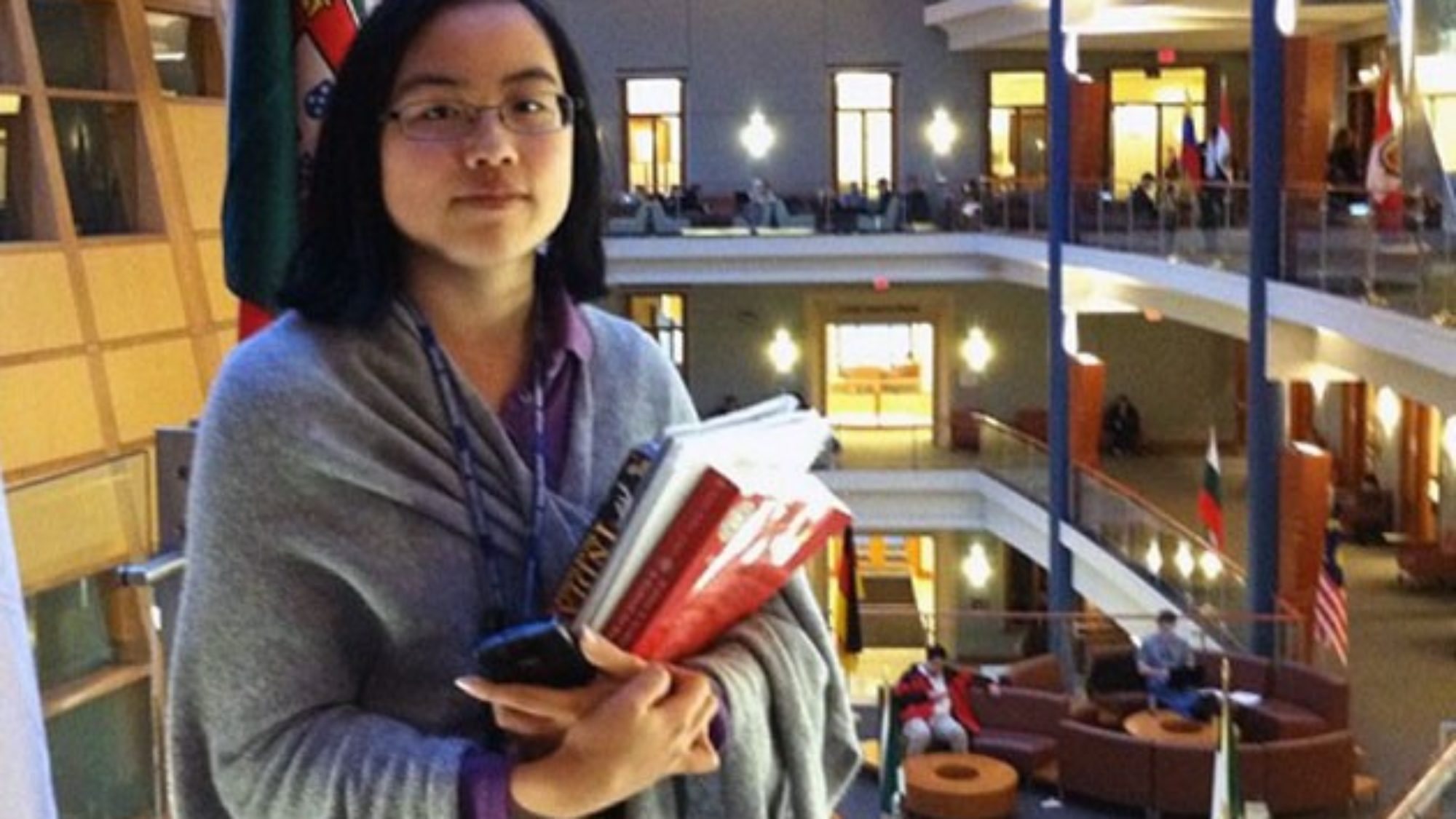 Lydia Brown holding books inside the business school
