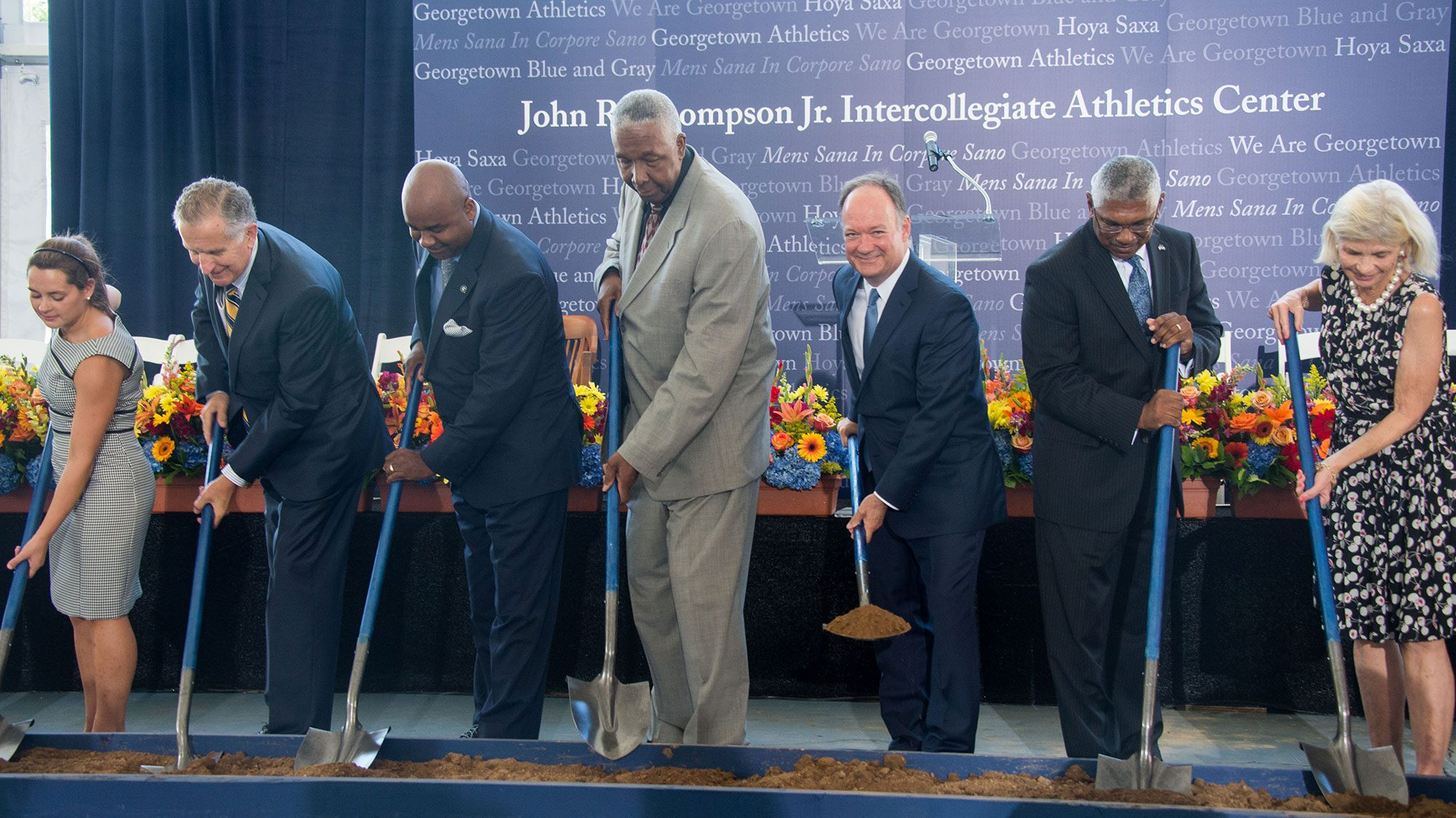 Alumni donors and other members of the Georgetown community join John Thompson Jr. and Georgetown President John J. DeGioia with shovels for the ground-breaking.