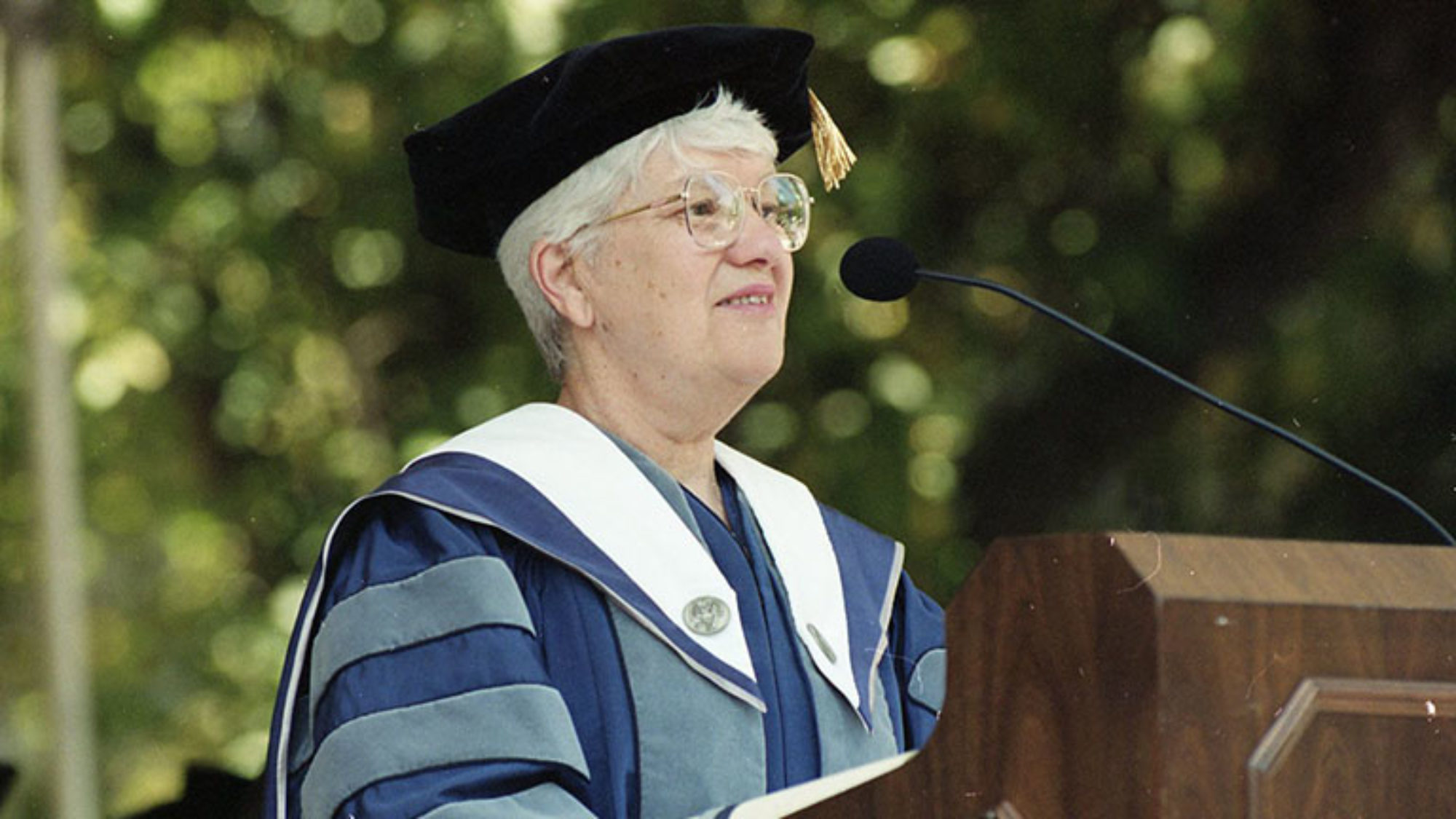 Vera Rubin at a podium wearing cap and gown