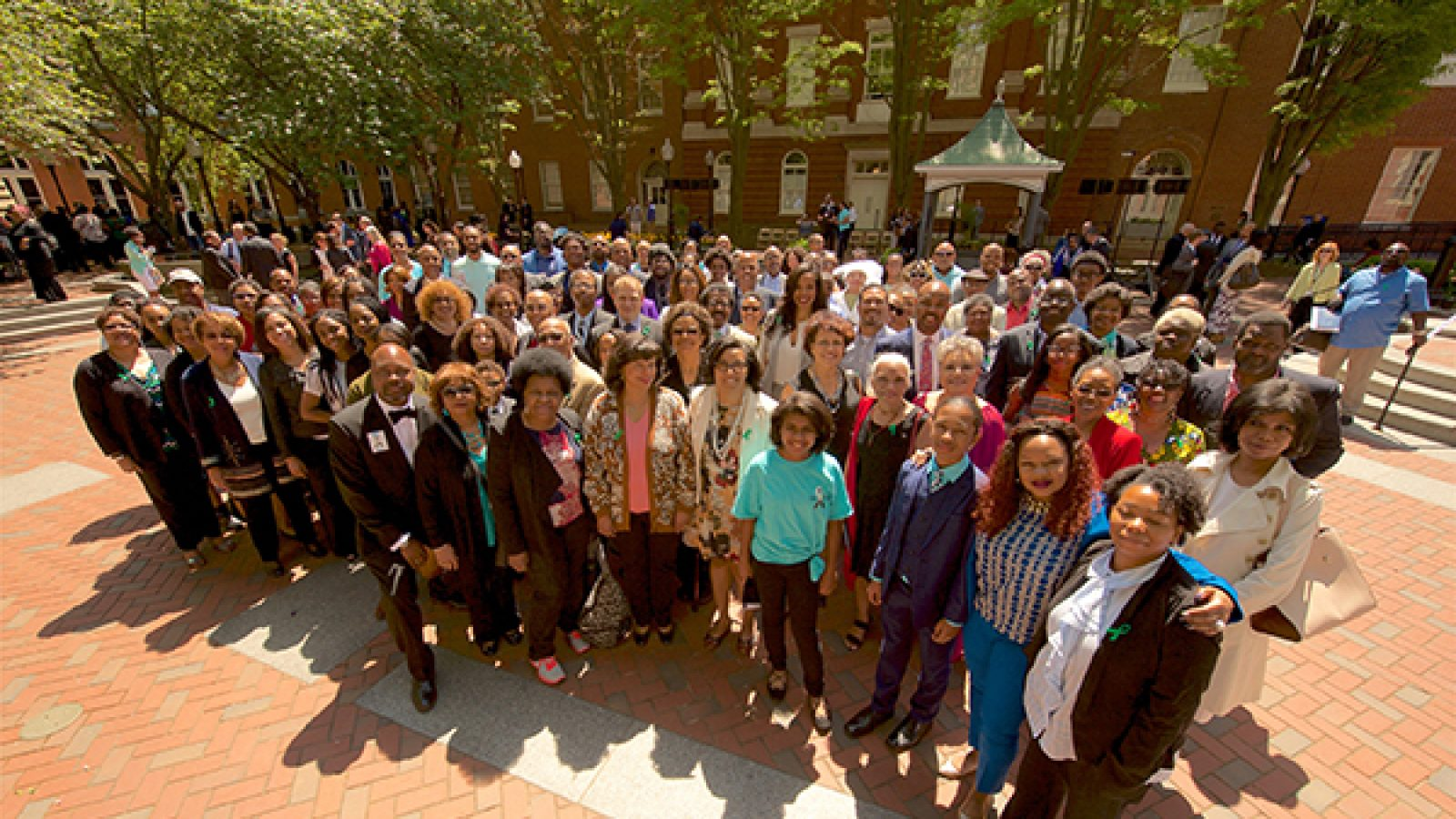 Descendants of the more than 270 enslaved individuals sold by the Maryland Province of Jesuits stand in front of Isaac Hawkins Hall