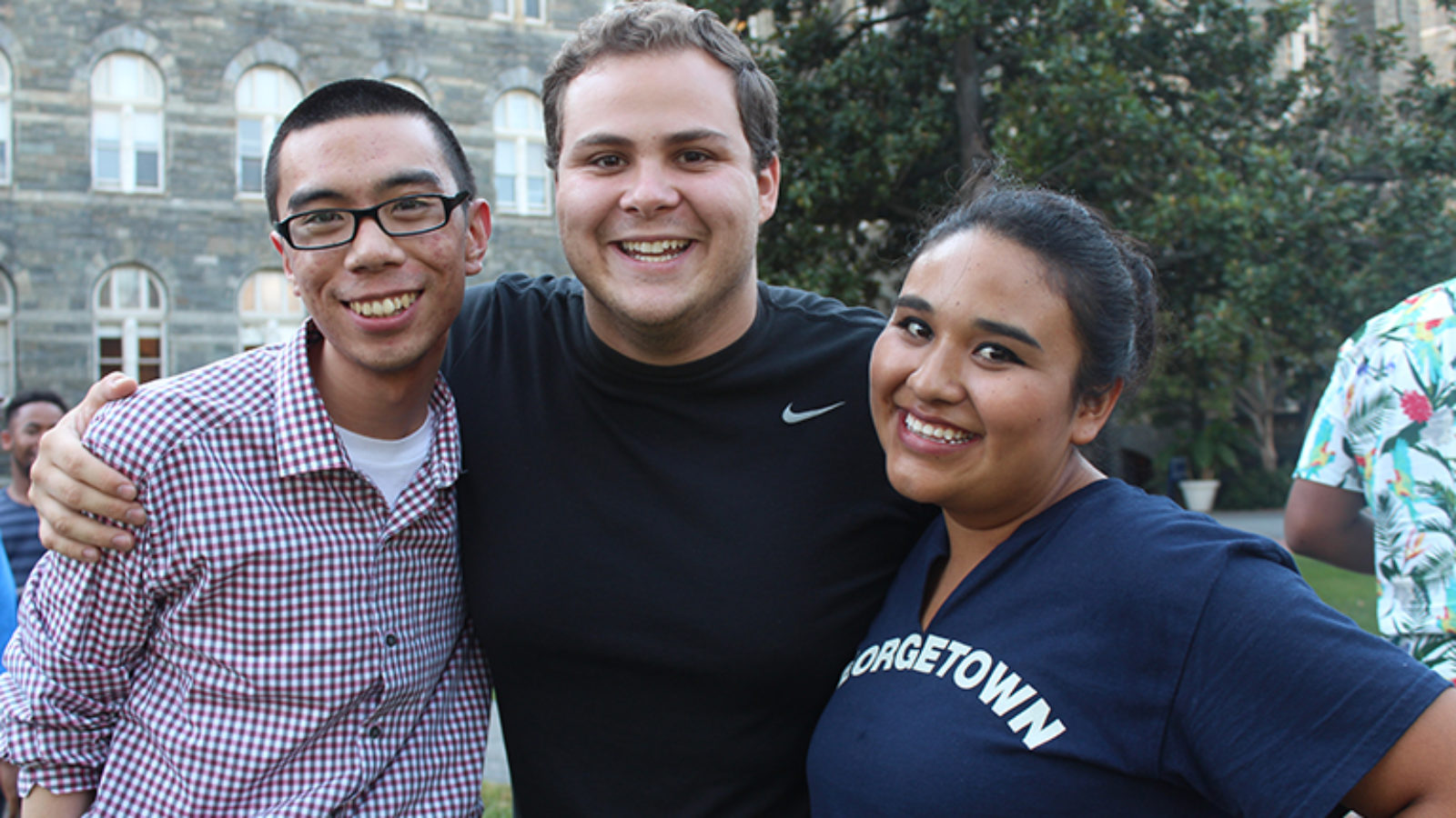 Three Georgetown students smile for the camera.