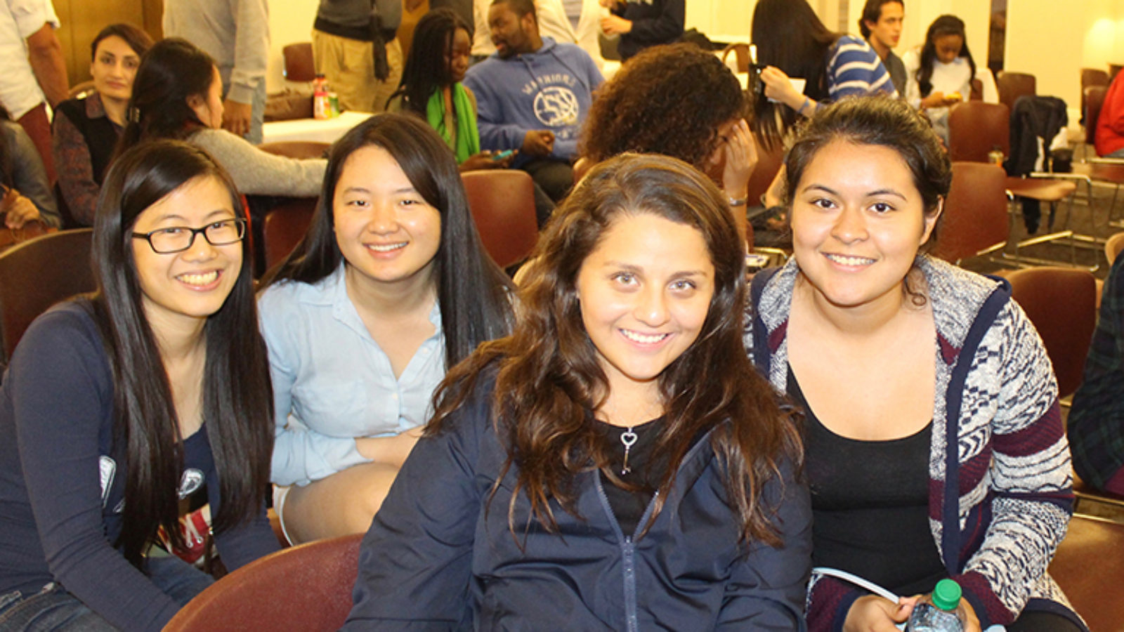 Students Florence Kong, Yingyu Ren, Angie Molina (C'18) and Jessica Andino sit together at an event.