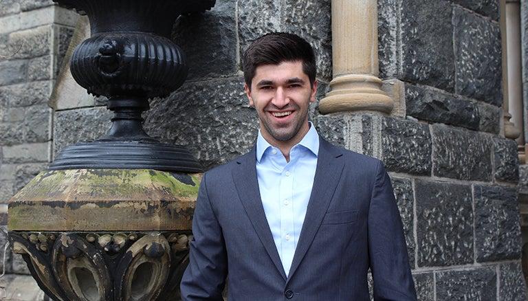 Tomás Álvarez Belón smiling in front of a stone wall.