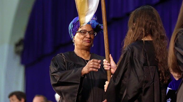 Melisande Short-Colomb holding flag