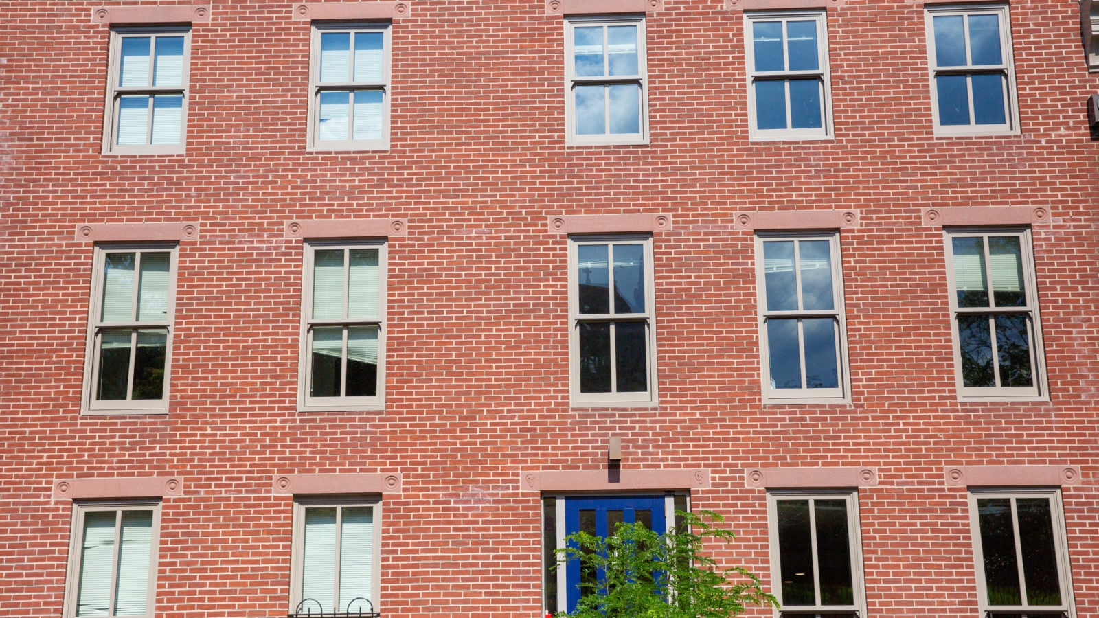 Photo displays a red bricked building.