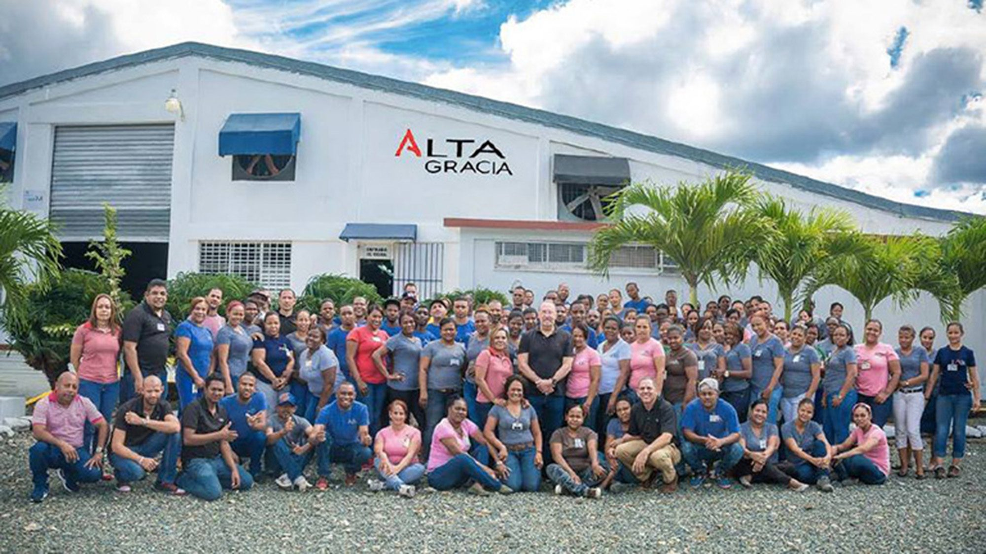 A large group of workers in front of the Alta Garcia apparel plant