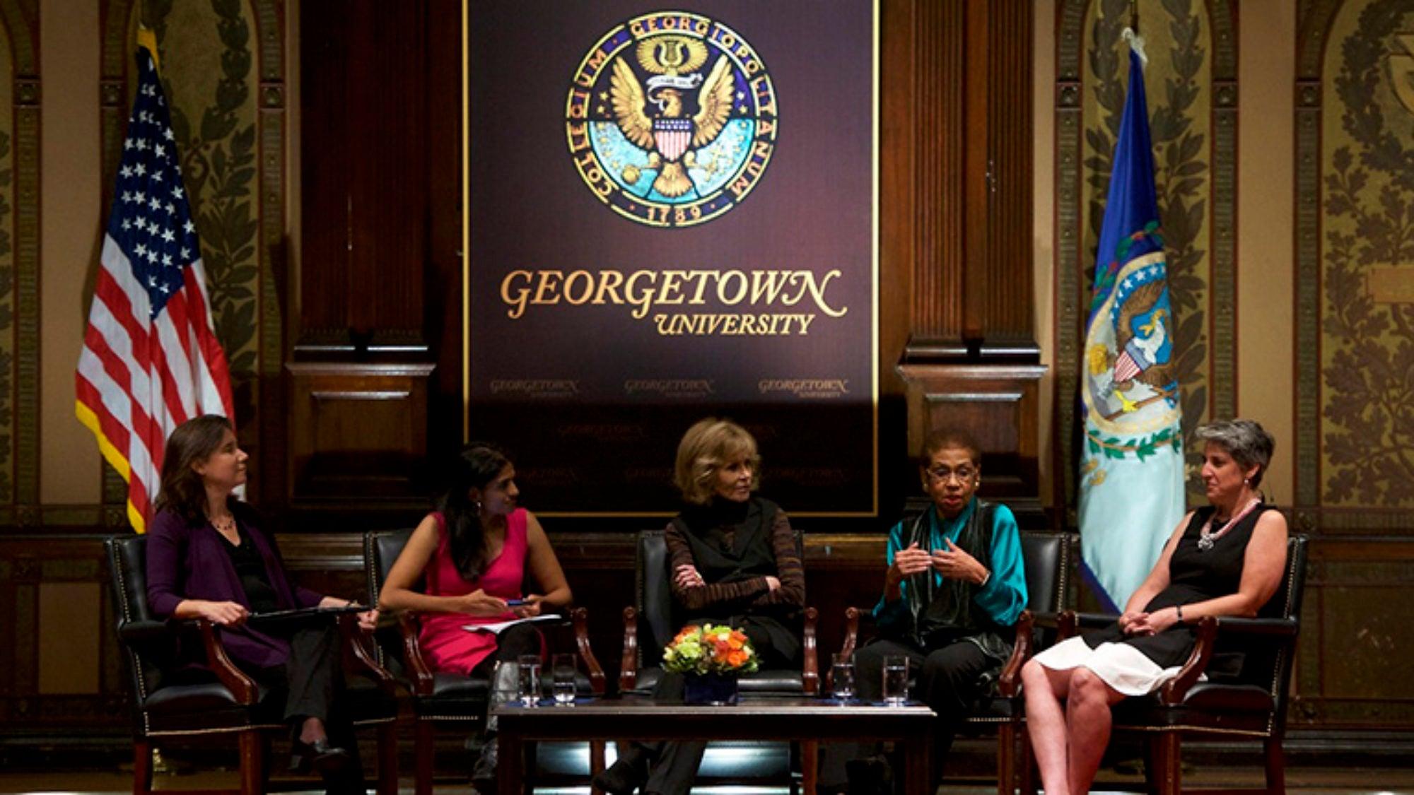 Lane Windham, Saru Jayaraman, Jane Fonda, Eleanor Holmes-Norton and Elissa Silverman on stage in Gaston Hall