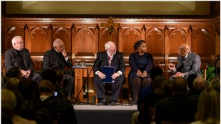 Jim Wallis, Wilton Gregory, John Carr, Marcia Chatelain and John Lewis sitting in chairs in Dahlgren Chapel