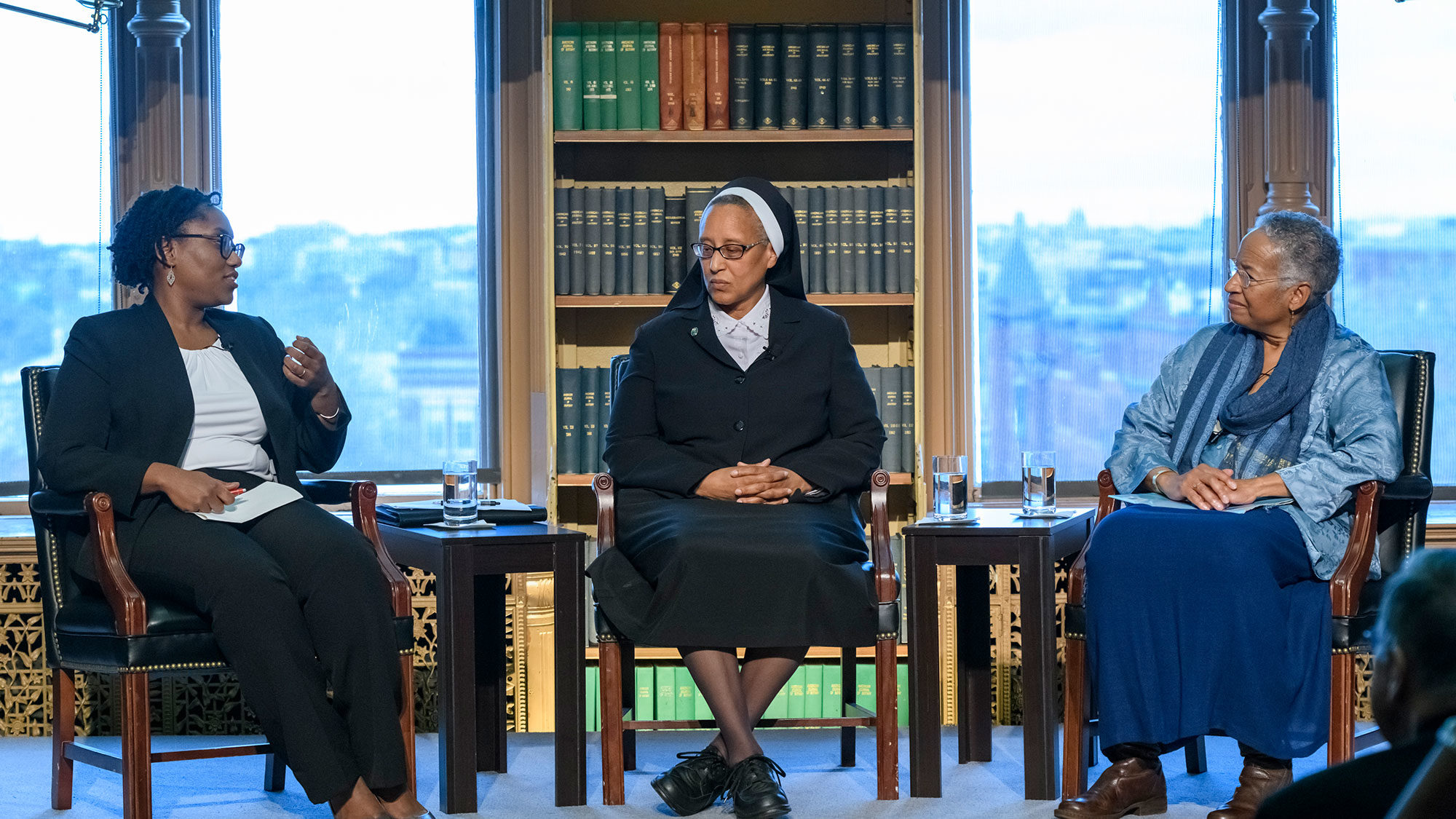 Marcia Chatelain, Marcia Hall and Diane Batts Morrow sit on stage and talk during a panel discussion.