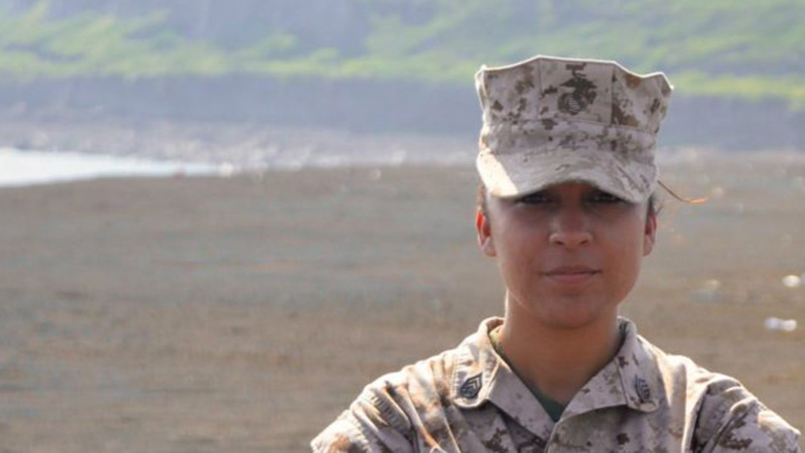 Jennifer Esparza wearing military fatigues in a desert area