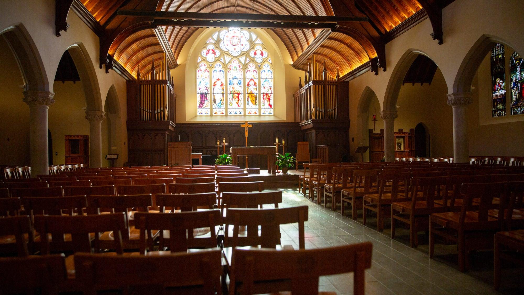 Rows of pews inside of Georgetown's Dahlgren Chapel.