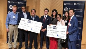 Shavini Fernando with students and Ted Leonsis helping hold oversized checks