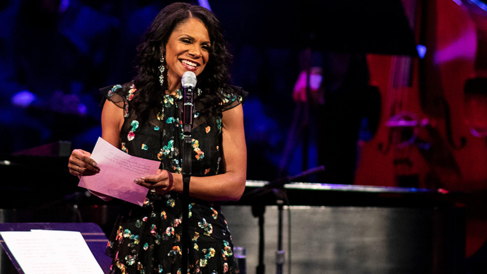 Audra McDonald speaks to the audience from the stage.