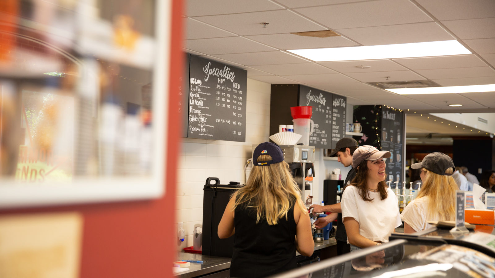 Students make coffee at a Corp-run coffee shop.