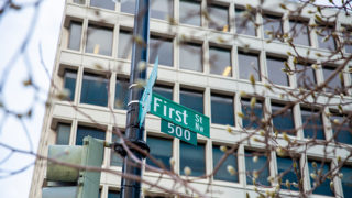 Photograph showing a building with the street sign reading First Street 500