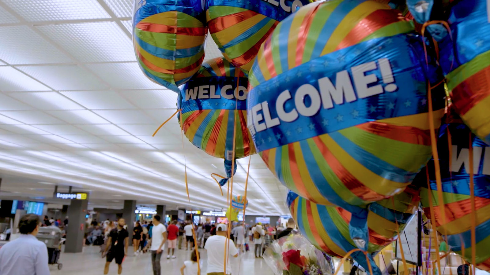 Welcoming balloons float at Dulles Airport