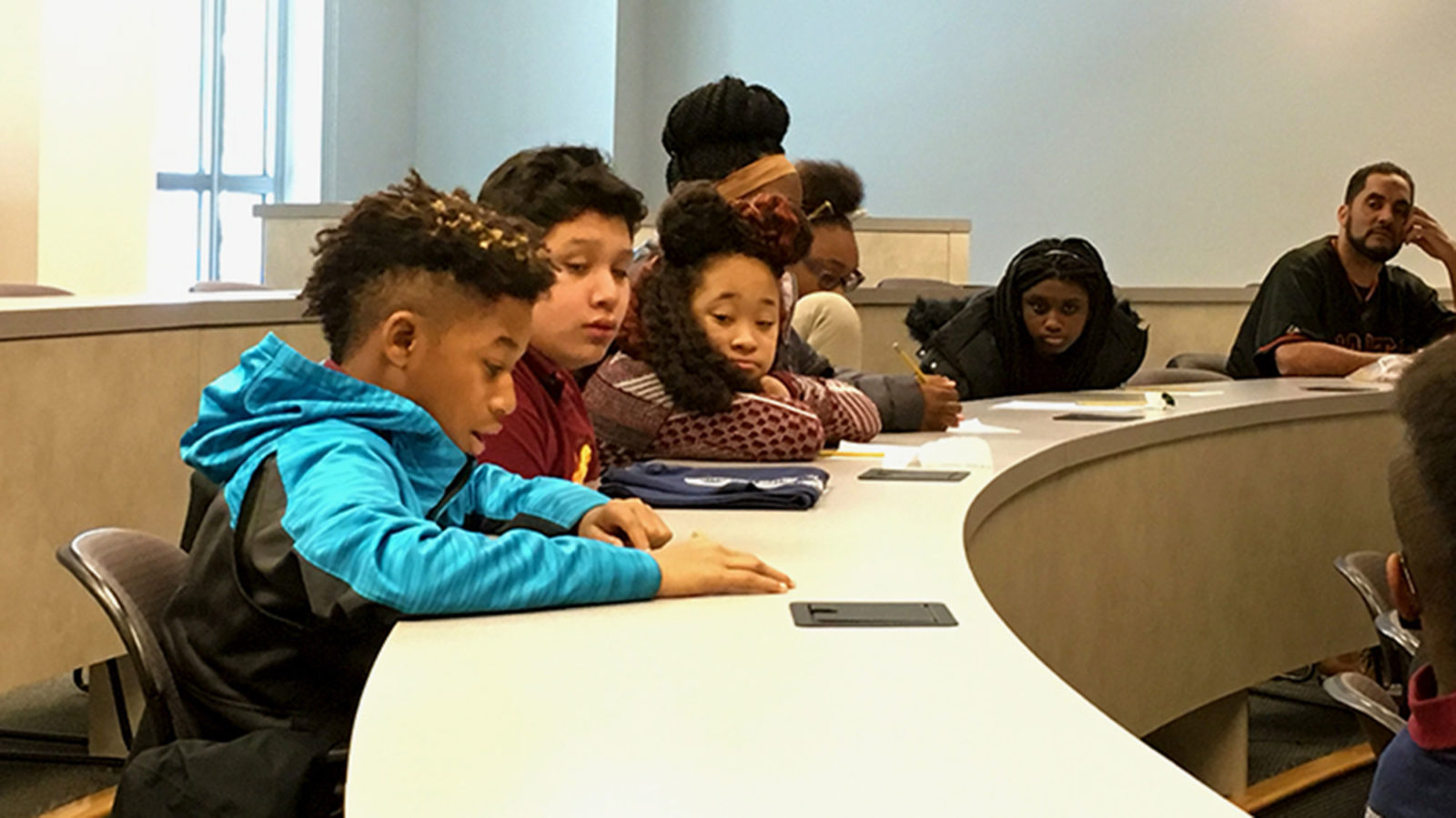 Students in Georgetown's Kids2College get an early start at the halfway point in their K-12 journey, an important year to begin preparing students for higher education.