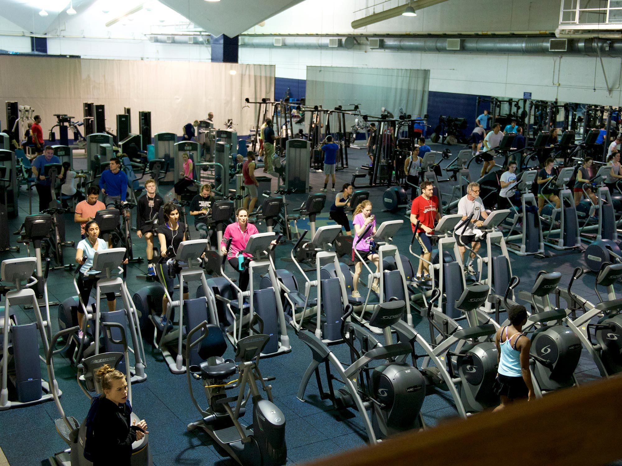 Students, faculty, and staff work out at Yates Field House