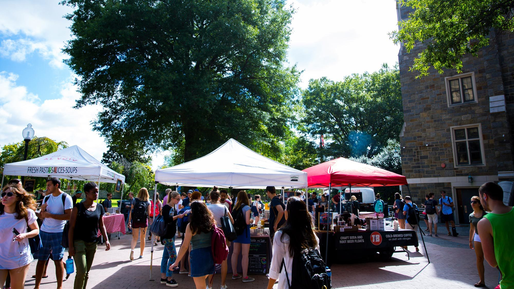Local food vendors set up tents on campus to offer dishes to students during the weekly Farmer's Market.