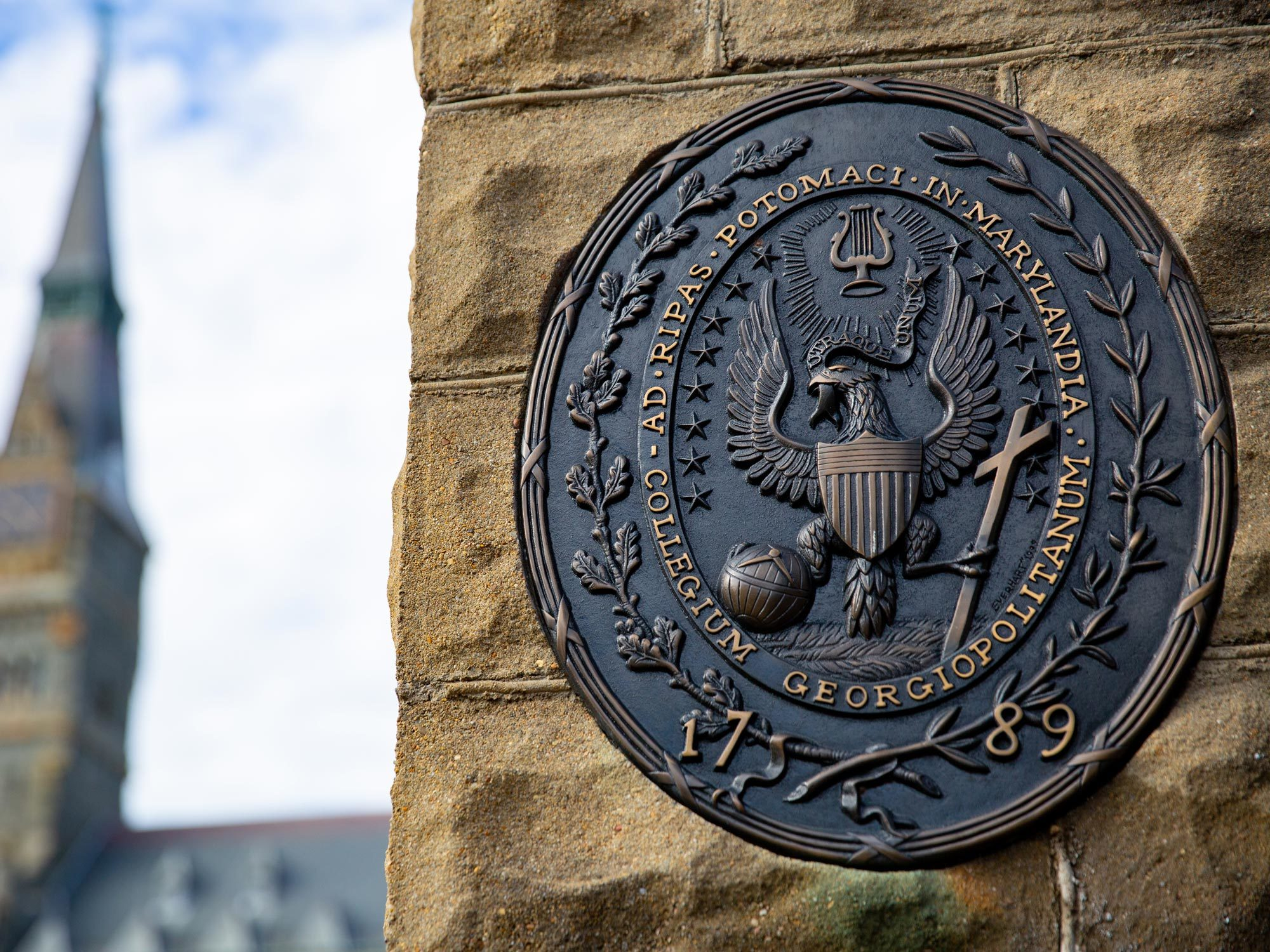 The Georgetown seal on the front gates of campus