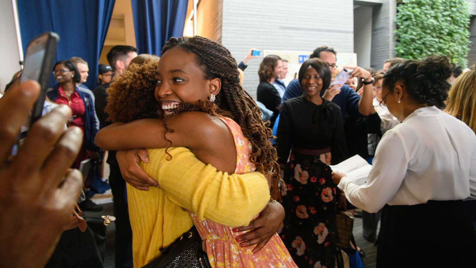 A School of Medicine student hugs her family on Match Day.