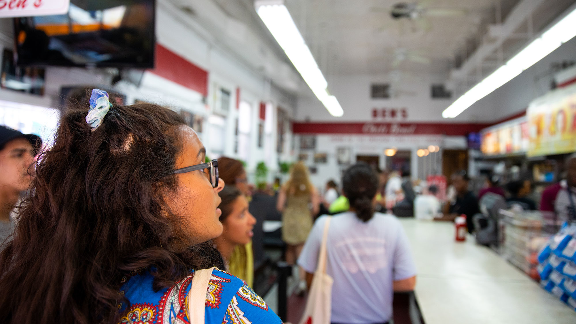 A student orders at Ben's Chili Bowl