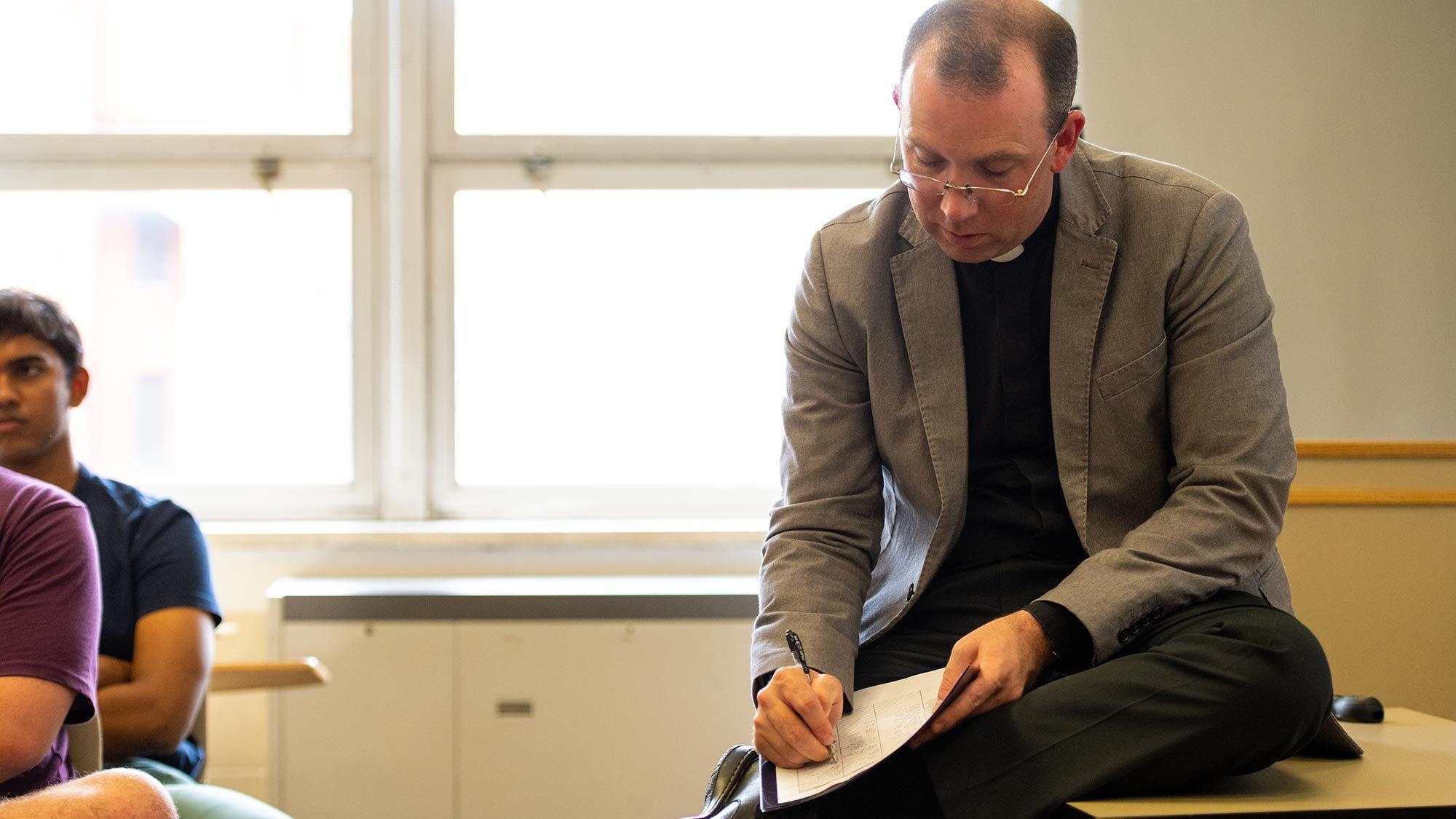 Fr. Peter Folan teaches a class