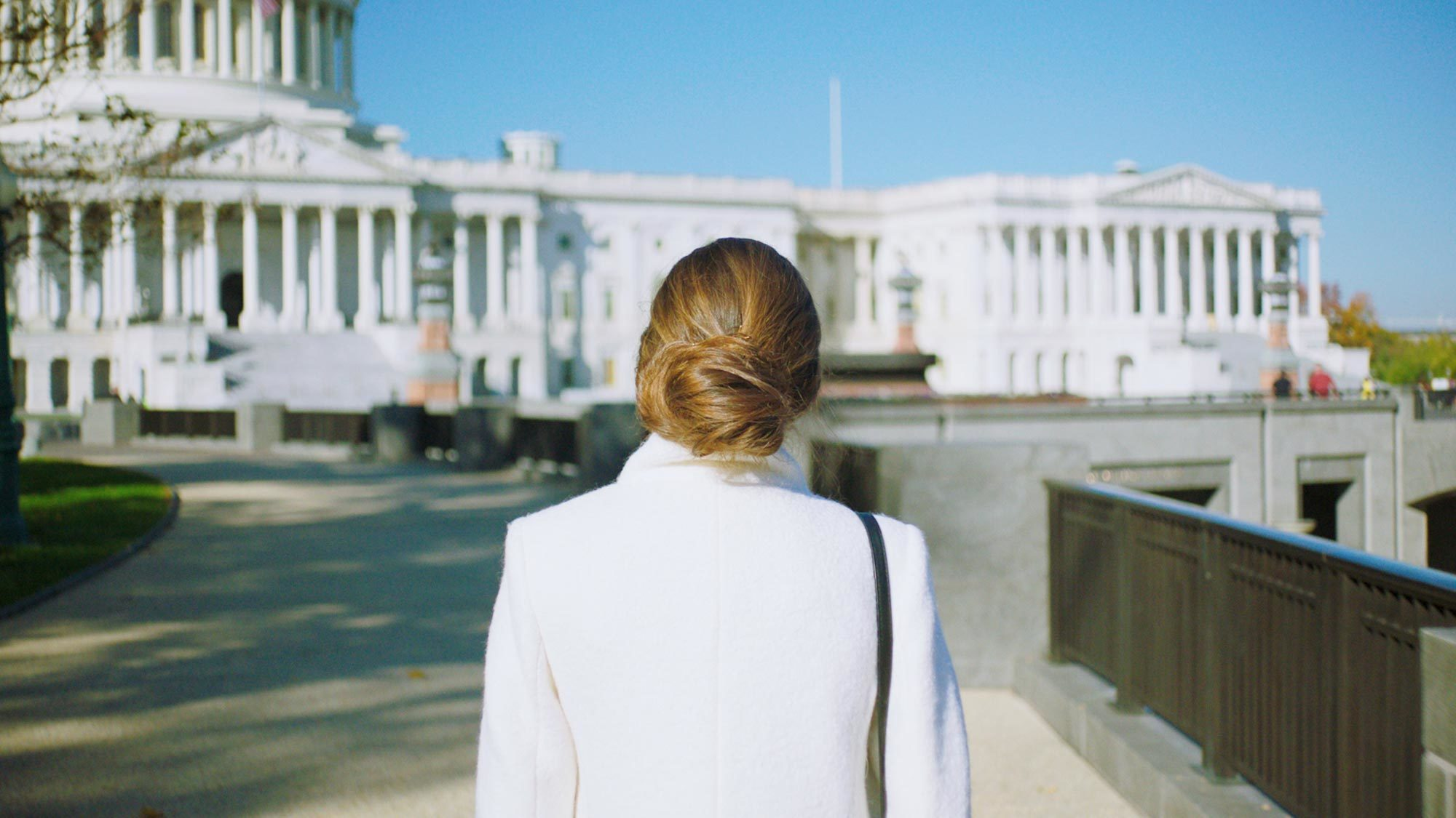 A woman walks toward the U.S. Capitol building