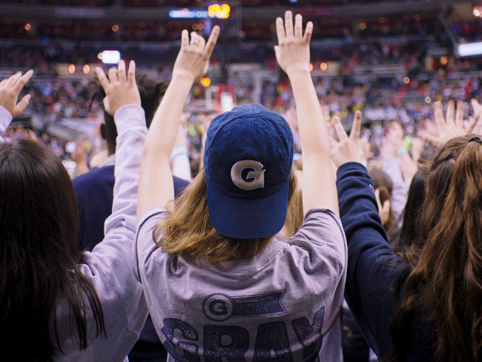 Students cheer at a sporting event in the Verizon Center.