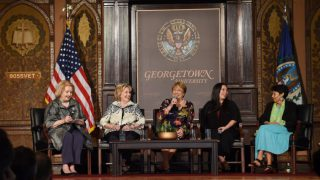 A panel in Gaston Hall featuring Hillary Clinton.