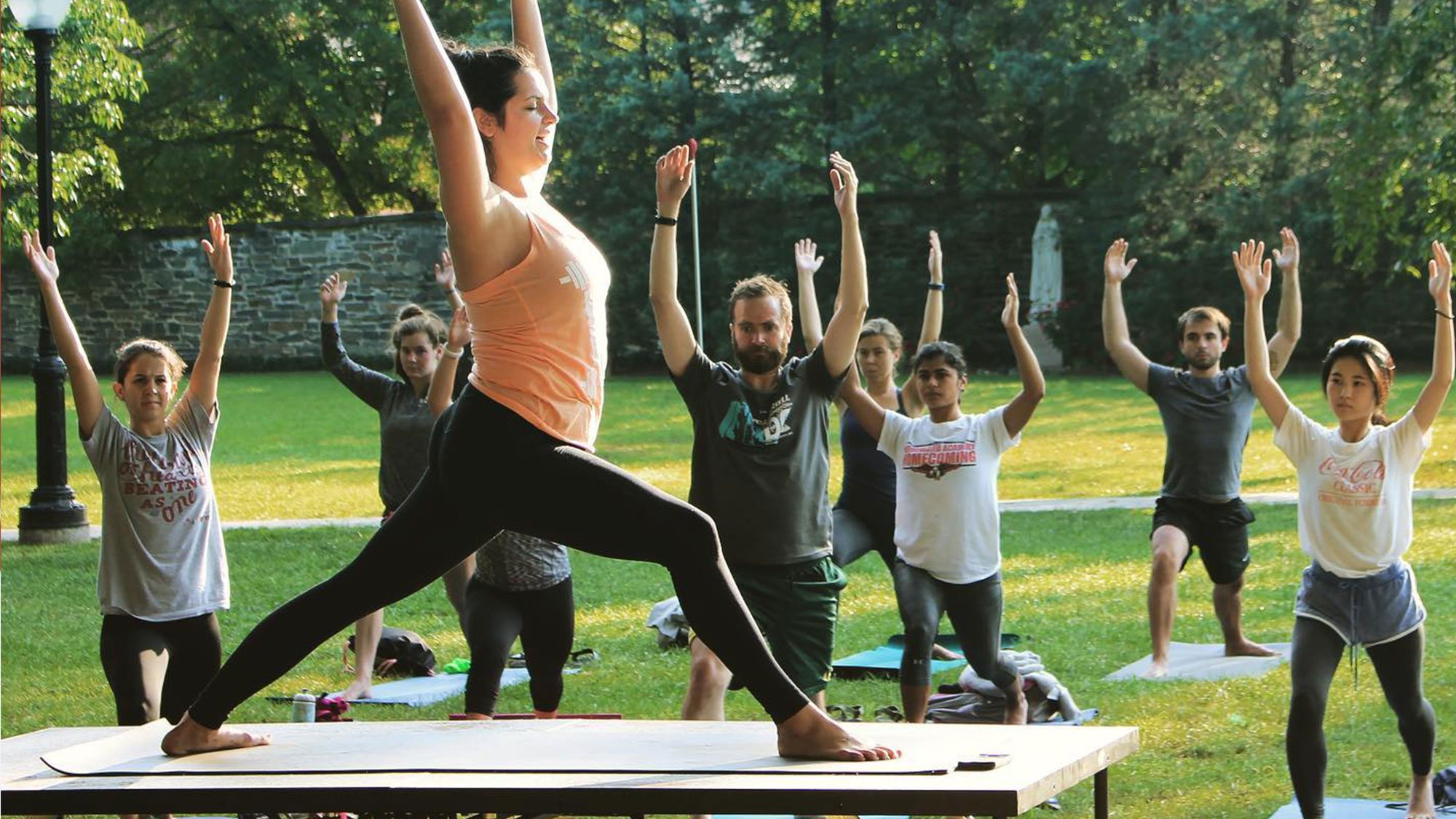 A group performs yoga on Georgetown's front lawn.