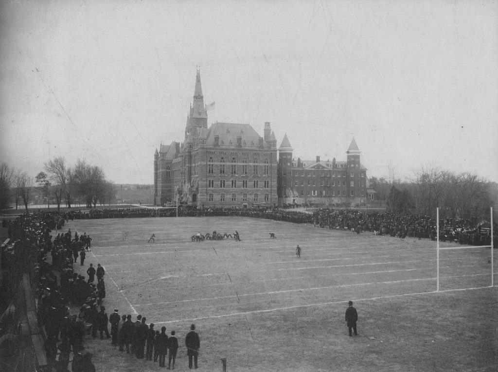 Students play sports on the front lawn of historic campus.