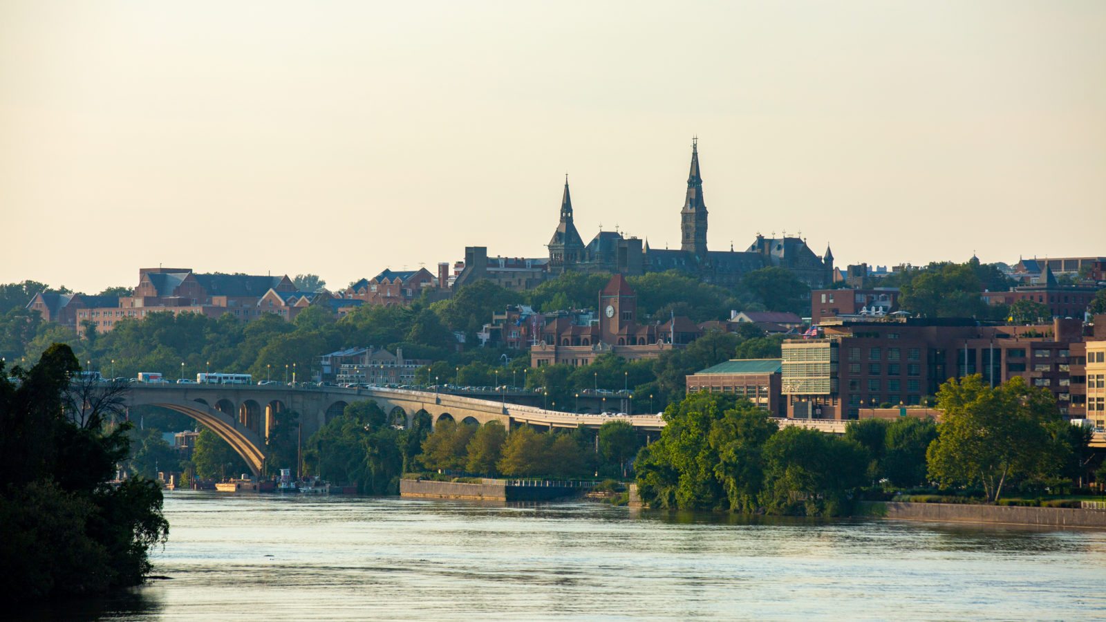 Georgetown is framed in the photo on the waterfront during sunset.
