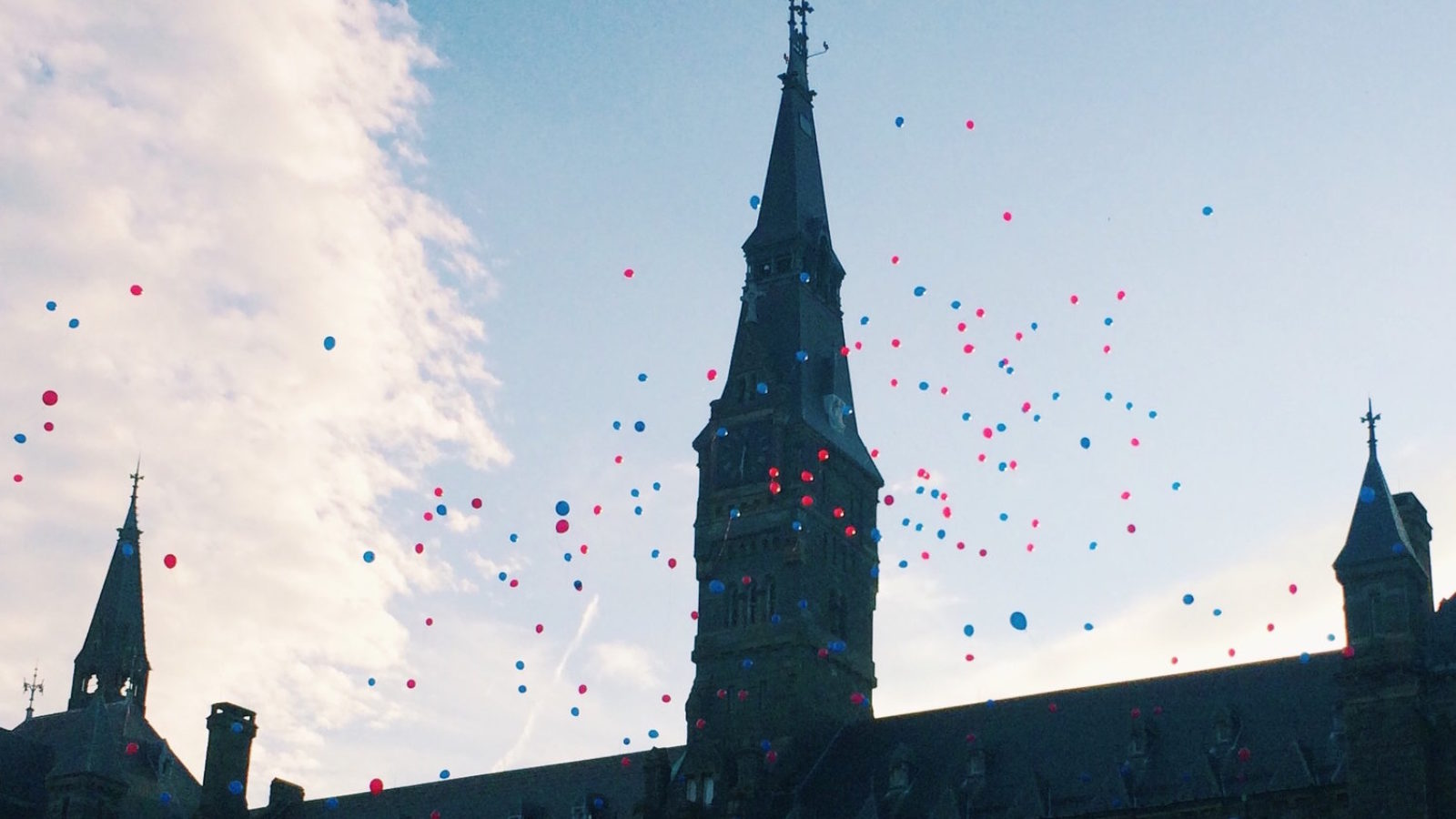 Balloons float over Healy Hall