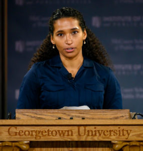 Erica Turner speaks at a lectern with Georgetown University carved into it.