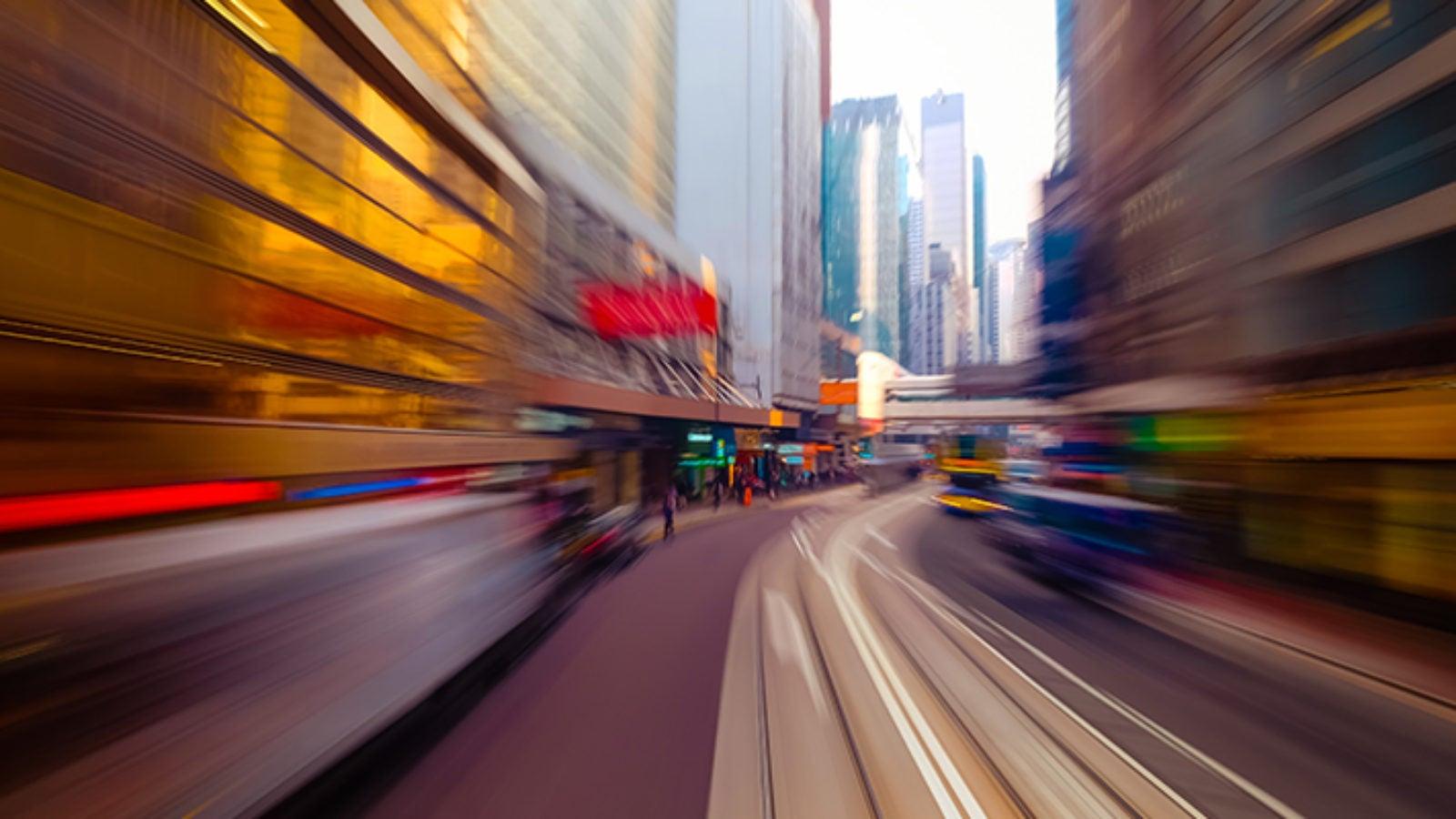 blurred image of road between skyscrapers