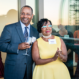 Sandra Jackson with husband Rev. Alonzo Jackson Sr. standing, with Alonzo holding a wine glass