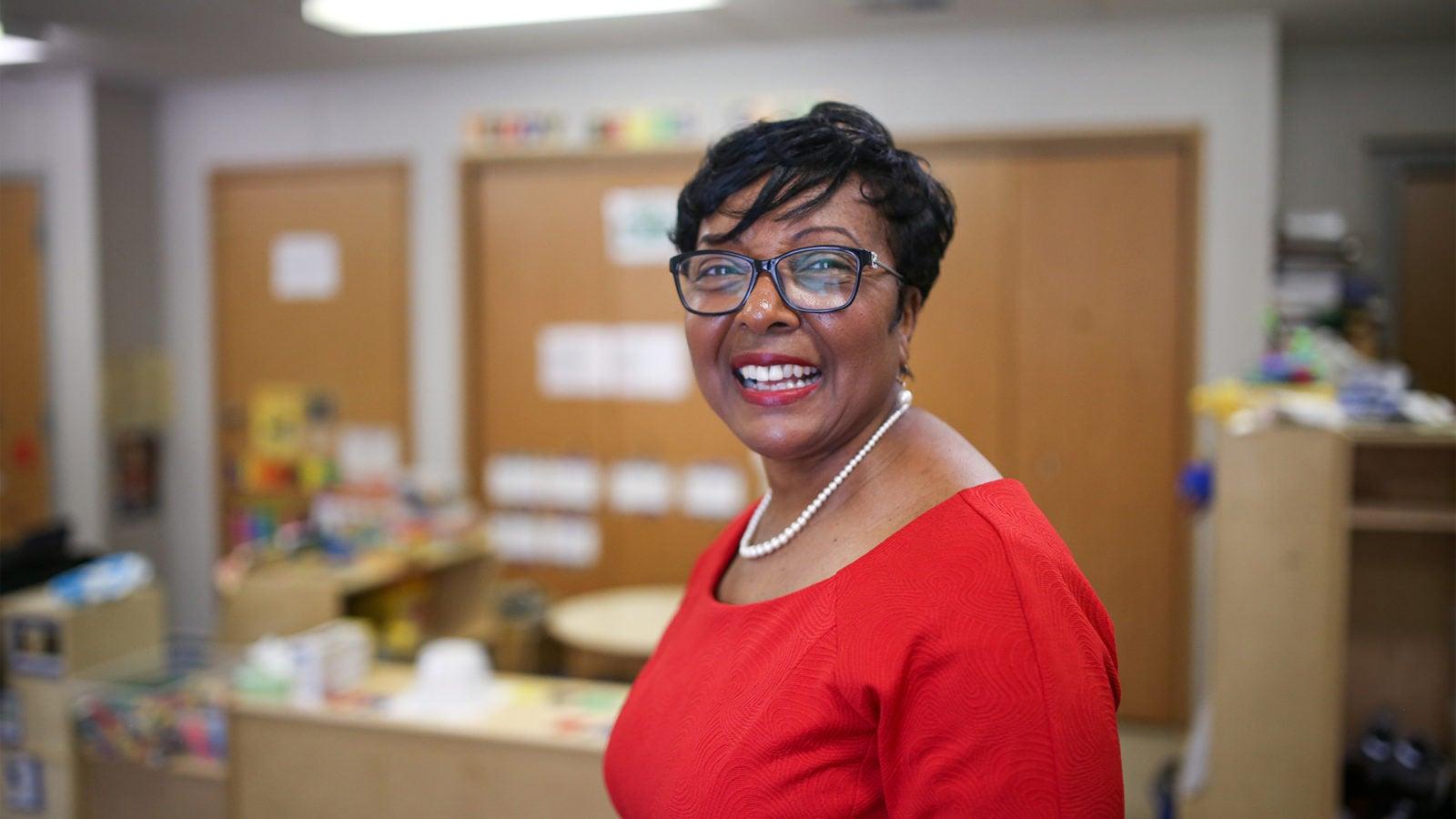 Sandra Jackson standing in front of some desks