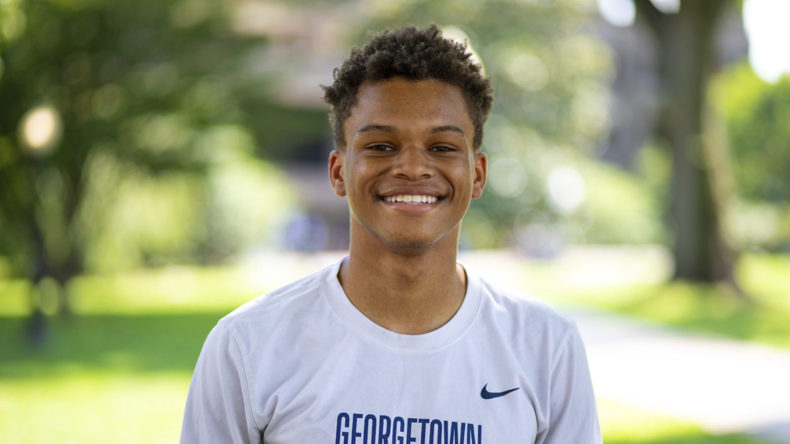 Josiah Laney wearing a Georgetown track and field T-shirt