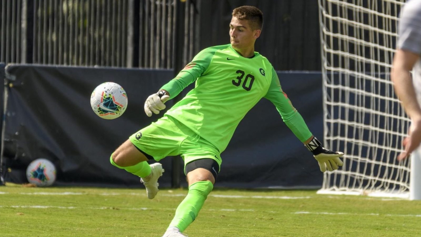 Tomas Romero kicking a soccer ball