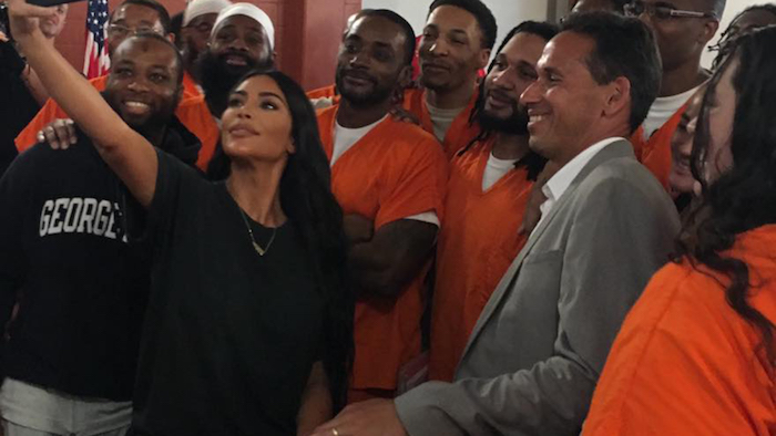Kim Kardashian takes a selfie with participants in the Prison Scholars Program and Professor Marc Howard