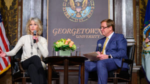 Jane Fonda and Pete Mara sit down on stage and talk to the audience.