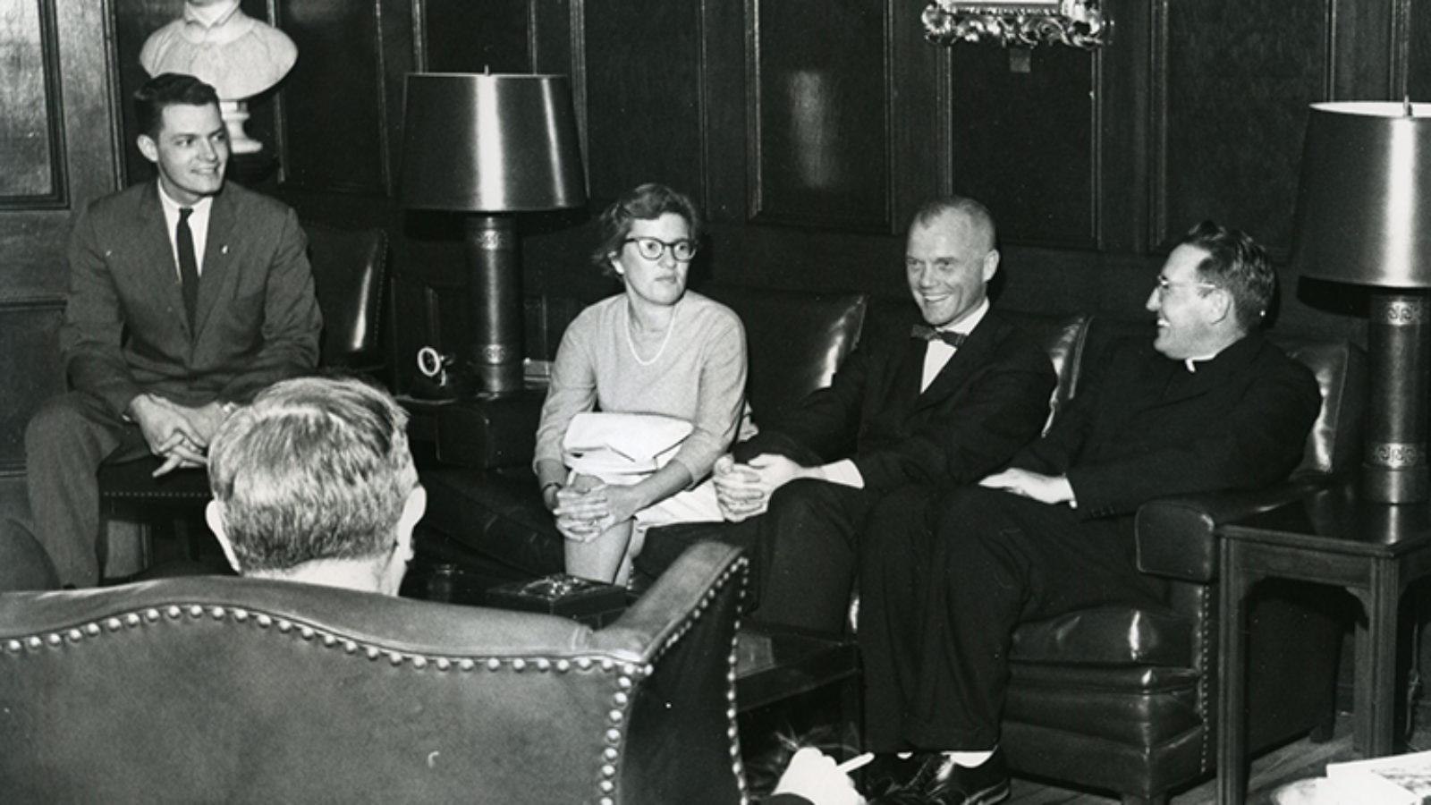 Vera Rubin with John Glenn and other men sitting around in chairs