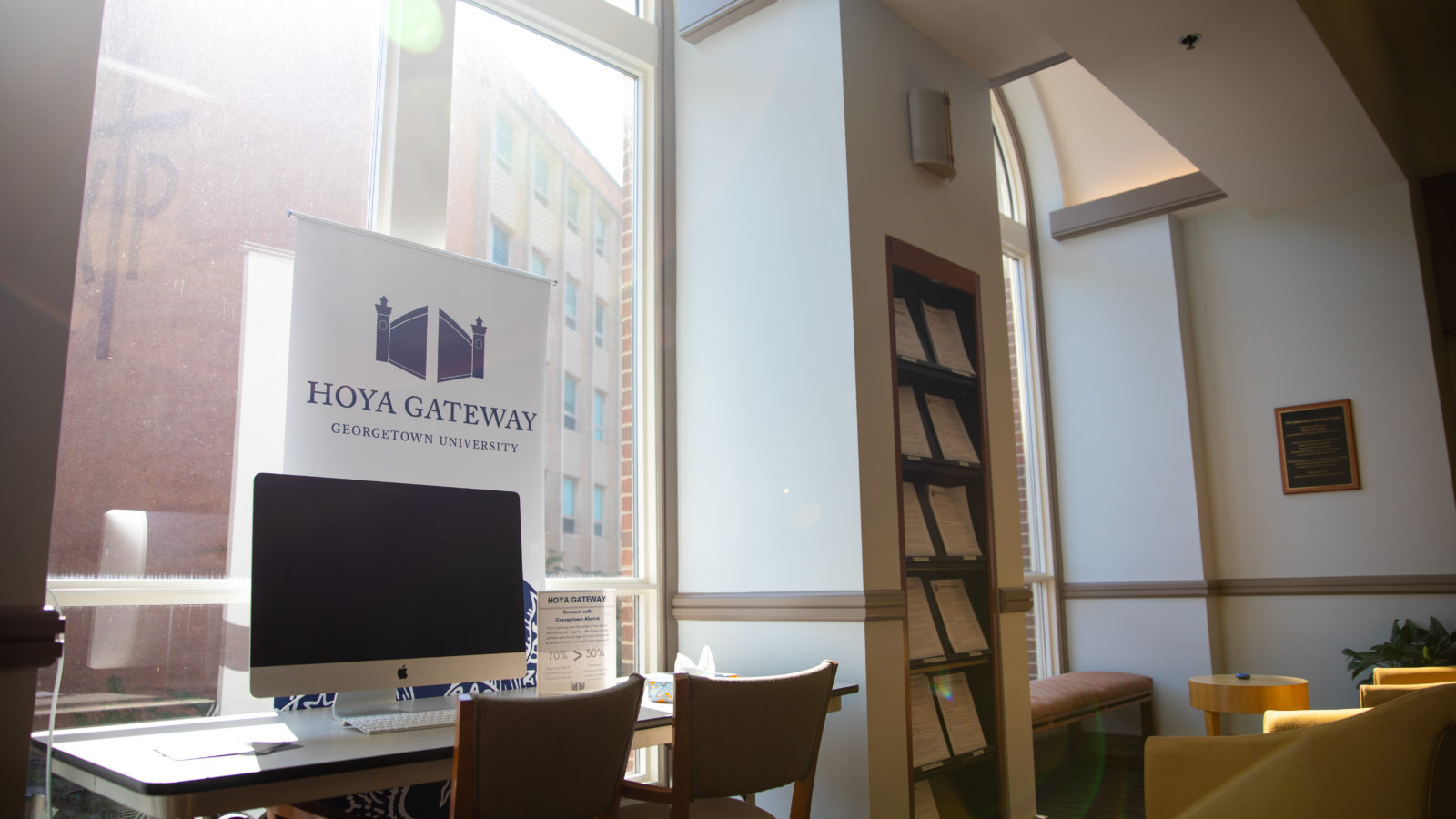 The sun shines through a window in the Cawley Career Center.