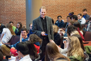 Matthew Carnes teaching, surrounded by students