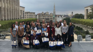 Susannah Dibble poses with a group of Fulbright-Schuman scholars in the European Union.