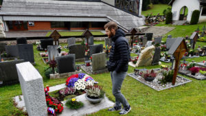 Douglas McKnight walks through a cemetery.