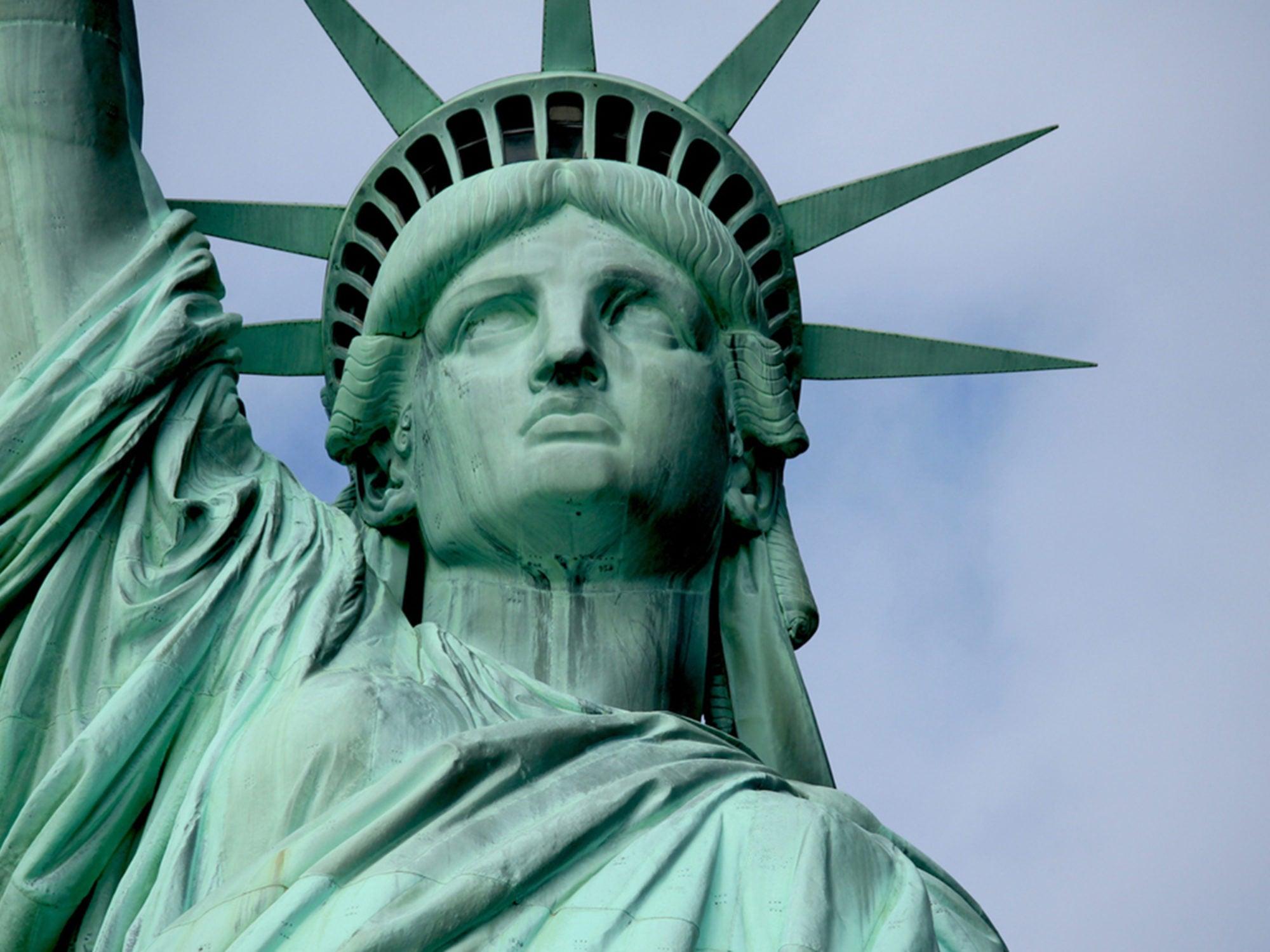 Closeup of top half of Statute of Liberty