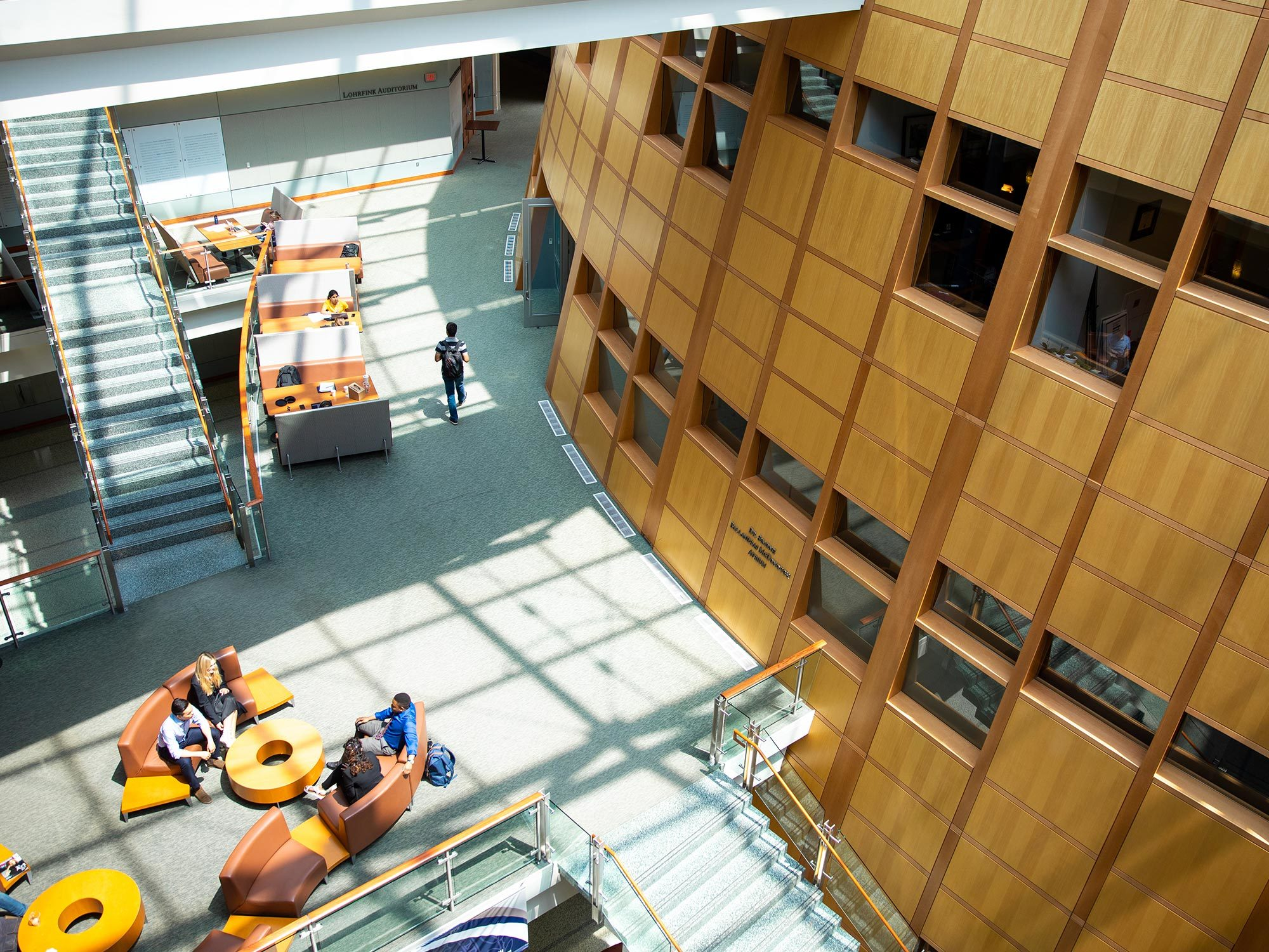 Students study in a sunny spot in the Hariri building