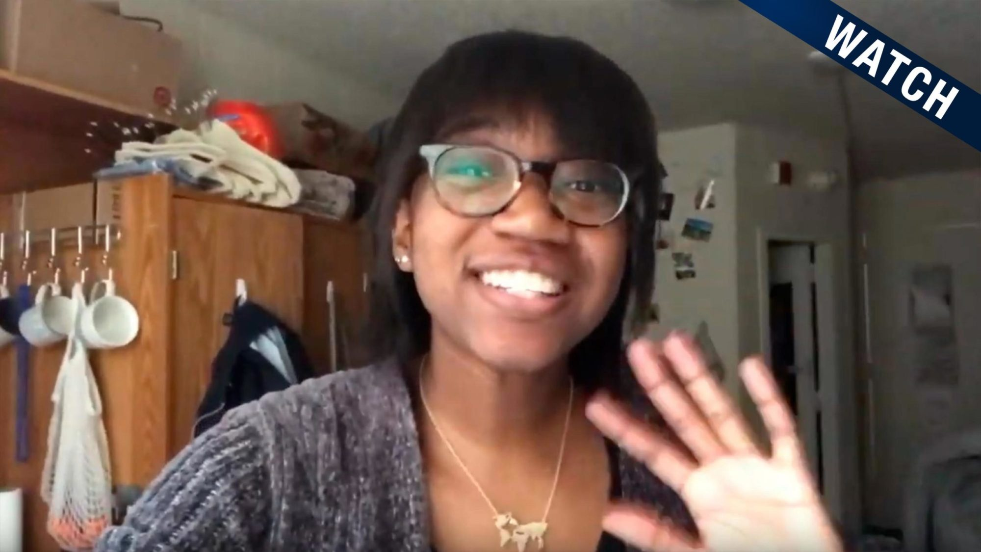 Trinity smiles in a screenshot from her Youtube vog